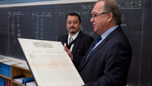 Aboriginal Affairs Minister Bernard Valcourt, right, visited a Grade 7 classroom in Ottawa this month with Assembly of First Nations National Chief Shawn Atleo to mark the 250th anniversary of the Royal Proclamation. Valcourt has released a draft of his department's First Nations education reform legislation.