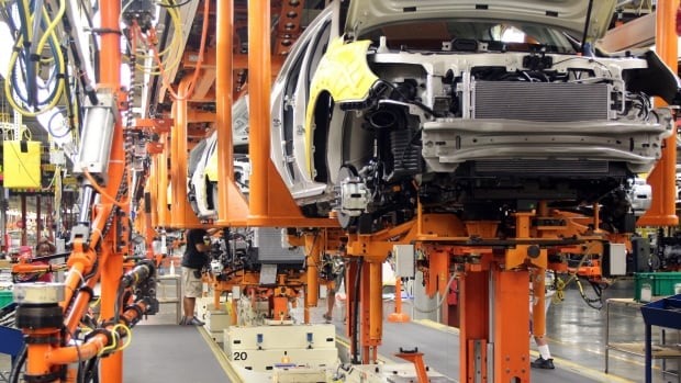 Cars are assembled at the General Motors manufacturing plant in Spring Hill, Tenn.  The U.S. exported a record number of cars in August.