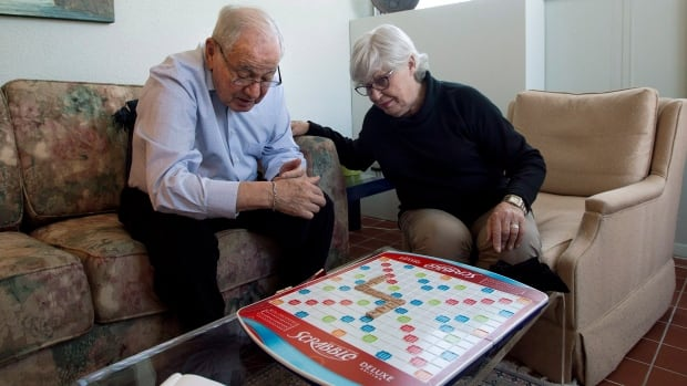 Sandra Atlin plays Scrabble with her husband Gordon, who has Alzheimer's disease, at their home in Toronto on Oct. 11. Most Canadians - about 91 per cent - would prefer to stay in their homes as they age.