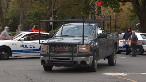 Montreal police investigate after a woman was struck by this pickup truck while crossing Wood St. at de Maisonneuve Blvd. West in Westmount.