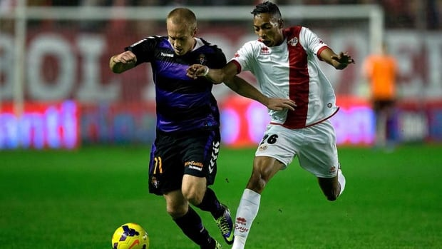 Daniel Larsson, left, of Real Valladolid CF is tackled by Johan Andres Mojica of Rayo Vallecano during their match at Estadio de Vallecas on Friday in Madrid, Spain.