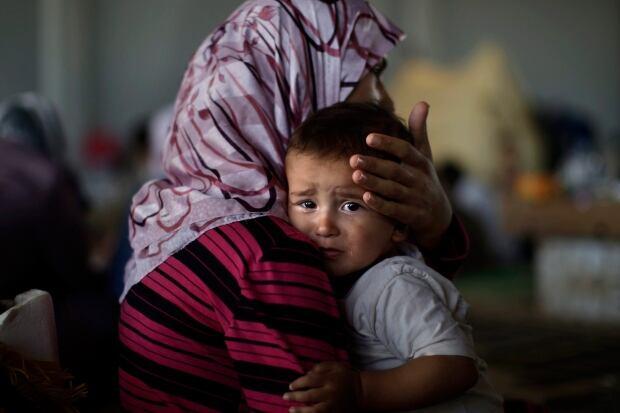 APTOPIX Mideast Syria Refugee Twins