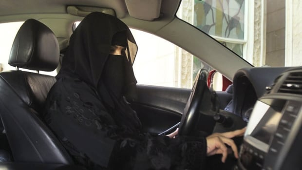 A woman drives a car in Saudi Arabia October 22, 2013. Saudi Arabia is the only country in the world where women are barred from driving, but debate about the ban, once confined to the private sphere and social media, is increasingly spreading to public forums. Faisal Al Nasser/Reuters