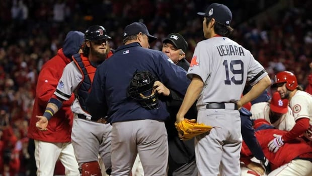 Manager John Farrell and Jarrod Saltalamacchia (39) of the Boston Red Sox argue an obstruction call with home plate umpire Dana DeMuth in the ninth inning against the St. Louis Cardinals during Game 3 of the 2013 World Series at Busch Stadium on Saturday in St Louis, Missouri.