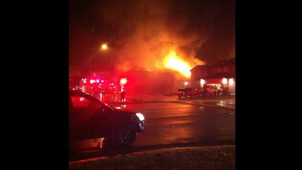 Two homes were destroyed by a fire in north Edmonton Sunday morning, causing an estimated $900,000 in damages.