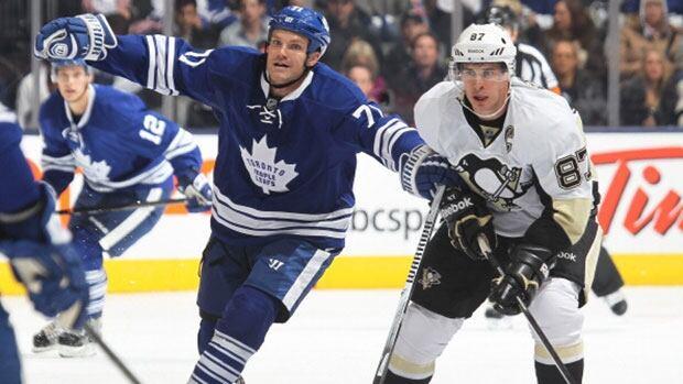 Leafs forward David Clarkson, left, helped shut down Pittsburgh star Sidney Crosby, right, Saturday night.