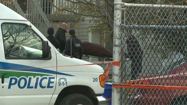 Gatineau police remove a body from a home on rue Montpetit Sunday, Oct. 27, 2013.