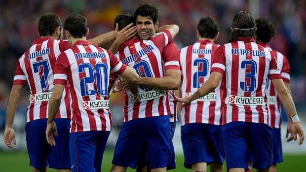 Diego Costa, fourth left, of Atletico de Madrid is congratulated by David Villa and teammates after scoring their team's fourth goal against Real Betis at Vicente Calderon Stadium on Sunday in Madrid, Spain.