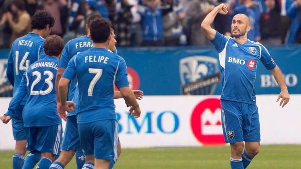 Montreal Impact's Marco Di Vaio, right, shown here last week, will be making a trip to the post-season after getting some external help on Sunday.