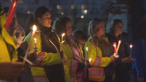 Hundreds of traffic flaggers lit candles and held flagging glow sticks to remember Vancouver Island woman Maggie Feeley, 29, who died after being injured on the job last week.