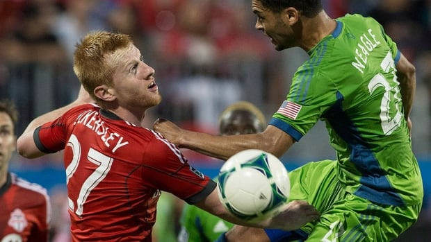 Toronto FC 's Richard Eckersley, left, had an injury plagued 2013 season. His crime is he is too expensive in a league whose salary cap was $2.95 million US this season.