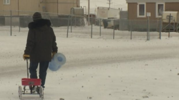Simon Okpakok makes this walk twice daily to get water for his family's home.