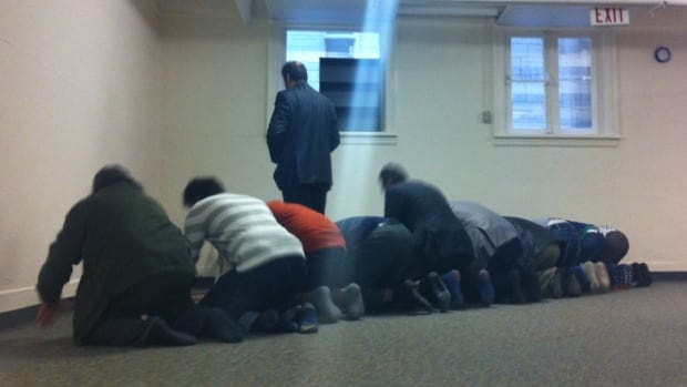 Students pray in the newly opened University of Winnipeg Musjid, a Muslim prayer room.