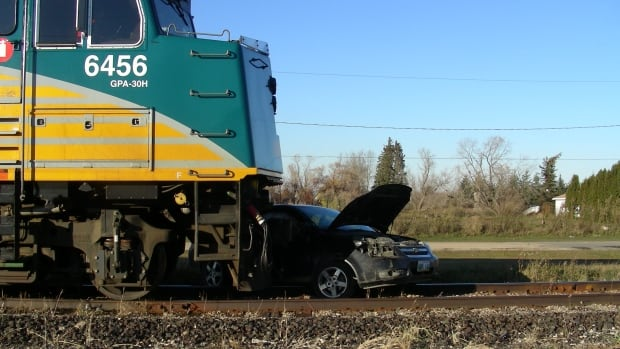A Via Rail passenger train and a car collided on the rail tracks near Highway 5 in Gilbert Plains, Man., on Monday afternoon.