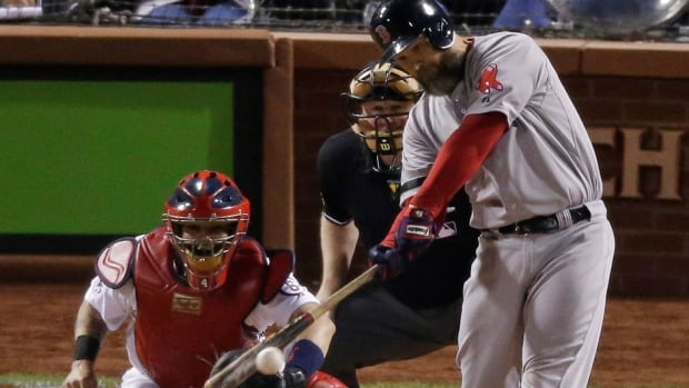 Red Sox's David Ross hits an RBI double during the seventh inning of Game 5 of the World Series on Monday night in St. Louis. He singled in the fifth after going 1-for-9 to start the Series. Ross says he's in awe of being in the World Series after dealing with concussion problems for much of the summer.