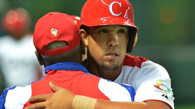 Cuban slugger Jose Abreu, right, batted .360 (9-for-25) with three home runs and nine RBIs at the World Baseball Classic last spring. He's expected to play first base or designated hitter for the White Sox.