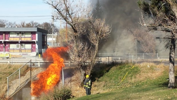 A massive fire sent flames shooting out of a culvert on Portage Avenue between Albany Street and Ferry Road on Tuesday.