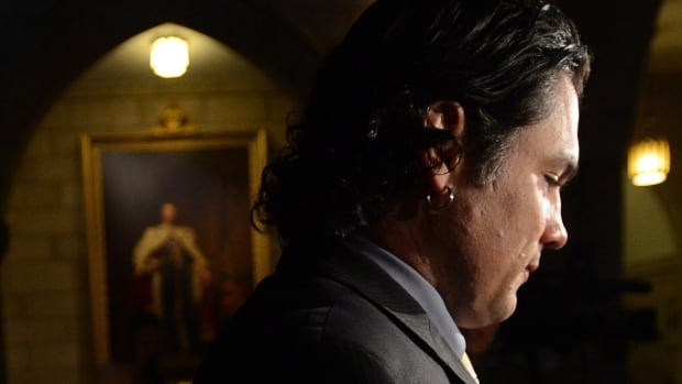 Senator Patrick Brazeau, one of three senators facing possible suspension without pay from the Senate over his expenses, arrives on Parliament Hill, Tuesday, Oct. 29, 2013.