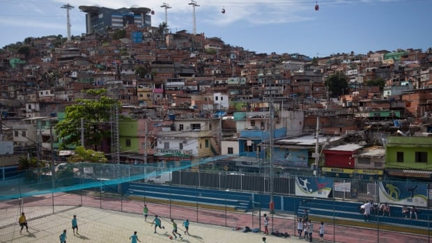 Kids play soccer at the Complexo do Alemao slum complex in Rio de Janeiro, Brazil. Rio's Cedae water utility cut off service to nearly a dozen Rio neighbourhoods Thursday as part of routine maintenance on a treatment plant on the Guandu River, the main water source for the city of six million.