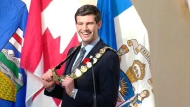 Don Iveson holds his chain of office after he is sworn-in as Edmonton's 35th mayor.