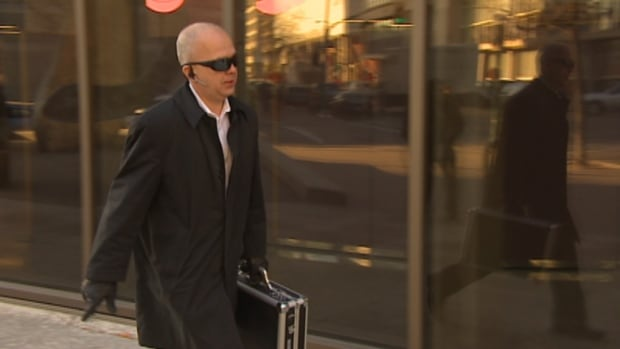Real estate broker David Douglas enters the Winnipeg courthouse on Wednesday.