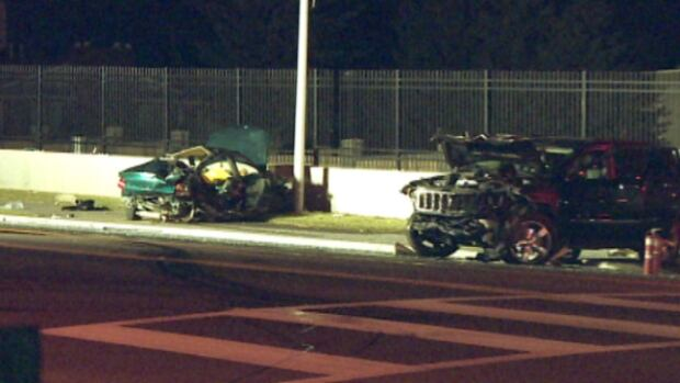 A green Dodge Neon and black Jeep lie crumpled near the intersection of 17th Avenue and 37th Street SW Wednesday night in Calgary after the Neon slammed head-on into the jeep. Two people died at scene and another died later in hospital.
