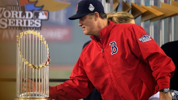 Red Sox manager John Farrell holds the World Series trophy after Boston defeated St. Louis 6-1 in Game 6 on Wednesday night. Farrell is  only the second manager since 1918 to win the Series in his first season managing a team.