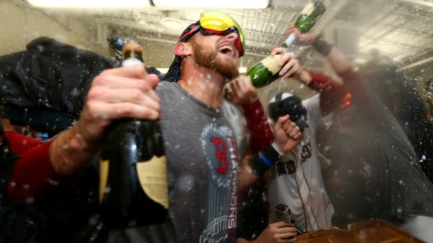 Will Middlebrooks of the Boston Red Sox celebrates in the locker room after defeating the St. Louis Cardinals 6-1 in Game Six of the 2013 World Series at Fenway Park on Wednesday in Boston, Massachusetts. Middlebrooks was one of several Red Sox players to take to Twitter Thursday to express his feelings after the historic victory.