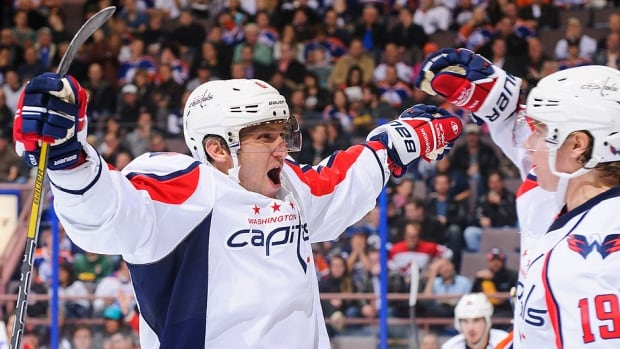 Capitals coach Adam Oates says forward Alex Ovechkin, left, would not make the trip to Philadelphia for Friday's game against the Flyers.