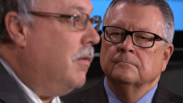 Liberal MP Ralph Goodale, right, looks on as ATU Local 279 president Craig Watson discusses Goodale's private member's bill to amend the Criminal Code.