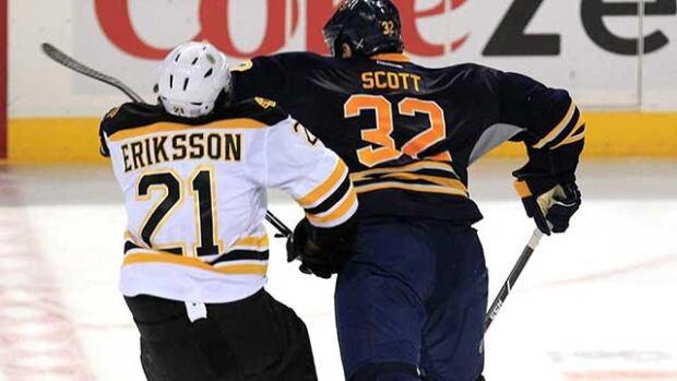 Buffalo Sabres forward John Scott, right, was penalized for this hit on Boston Bruins forward Loui Eriksson on Thursday.