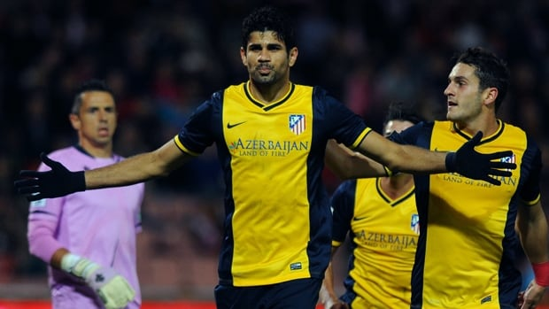 Atletico Madrid's Brazilian forward Diego da Silva Costa, centre, celebrates after scoring on a penalty kick against Granada on Thursday.