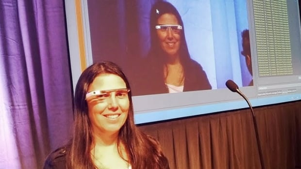 Software developer Cecilia Abadie wears her Google Glass  during a presentation. Abadie was pulled over for speeding on Oct. 29 in San Diego, and a California Highway Patrol officer tacked on a citation usually given to drivers who may be distracted by a video or TV screen.