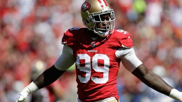 San Francisco 49ers linebacker Aldon Smith turned himself in to Santa Clara County authorities on Tuesday as he faces weapons charges.