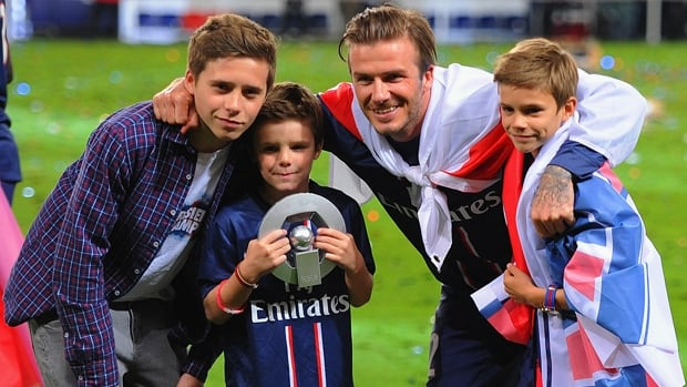 Brooklyn Beckham, left, had a training session with Manchester United, the EPL club once captained by father David Beckham.