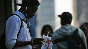 Teen drinks large soda pop