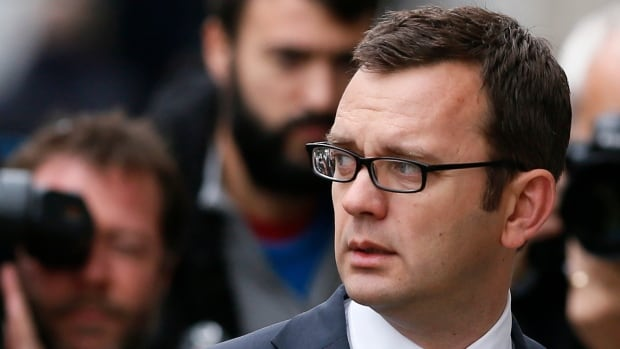 Former News of the World editor Andy Coulson arrives at the Old Bailey courthouse in London Friday. Coulson is on trial accused of conspiring to hack into phones of high-profile public figures or those close to him and also making illegal payments to public officials, charges he denies.