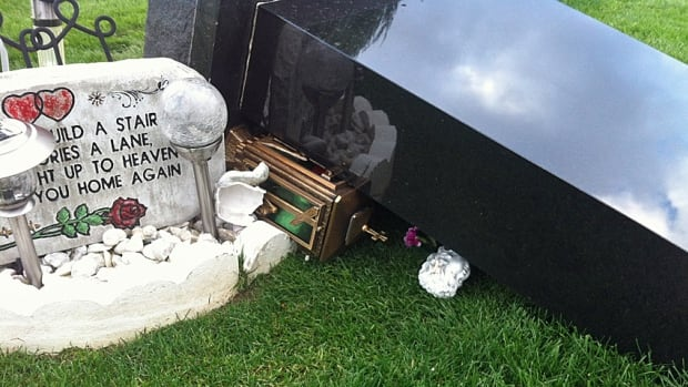 George Chamoun's tombstone was one of close to a dozen knocked over in the Mount Hamilton Cemetery Thursday night.