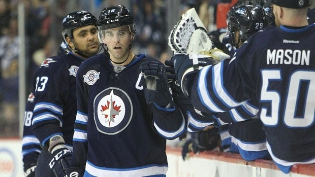 The Winnipeg Jets' Andrew Ladd, centre, and his teammates.
