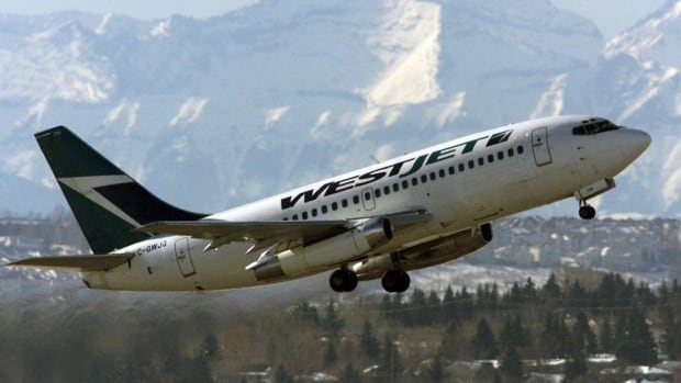 A WestJet plane takes off from the international airport in Calgary. Some flights to Los Angeles have been delayed, diverted or cancelled after a shooting today.