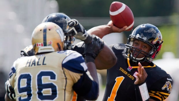 Hamilton Tiger-Cats quarterback Henry Burris, right, and his club are already headed to the post-season.