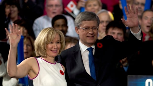 Prime Minister Stephen Harper and his wife, Laureen, wave after addressing delegates at the Conservative convention in Calgary on Friday.