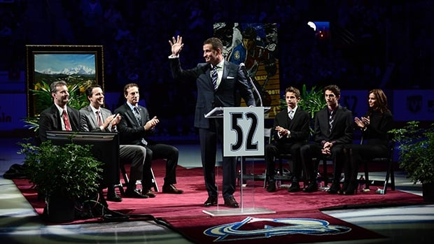 Colorado Avalanche former defenceman Adam Foote waves to the crowd during his jersey retirement ceremony before the game against the Montreal Canadiens at Pepsi Center on Saturday.