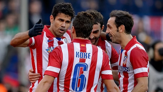 Atletico Madrid's Diego Costa, left, celebrates with teammates after scoring against Athletic Bilbao at the Vicente Calderon stadium in Madrid on November 3, 2013.