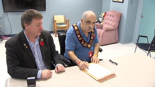 Gary Gosine, pictured here with MHA David Brazil, was official sworn in as mayor on Sunday.