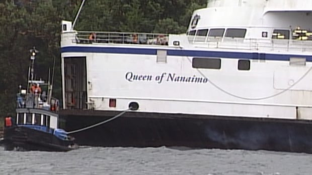 The ferry was tugged away after high winds sent it crashing into a private dock on Mayne Island, B.C.