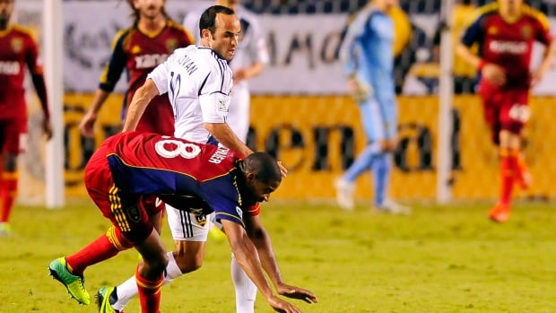 Los Angeles Galaxy midfielder Landon Donovan, back, and Real Salt Lake defender Chris Schuler collide while battling for the ball during the second half on Sunday in Carson, Calif.