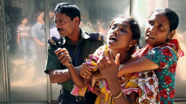 An unidentified relative of a Bangladeshi garment factory worker cries at the scene of a factory fire that killed 12 people in Gazipur outside Dhaka on Oct. 9. Bangladeshi workers' salaries will be raised to about $66 a month.