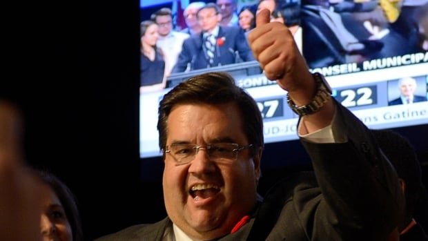 Denis Coderre celebrates after winning the mayoral election Sunday, November 3, 2013 in Montreal.