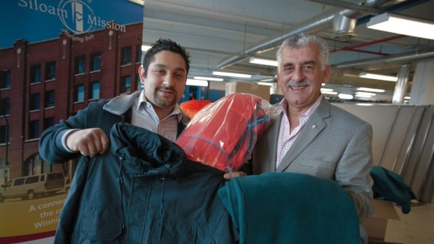 Albert El Tassi and his son Mohamed are donating sleeping bags, blankets and parkas to Siloam Mission.